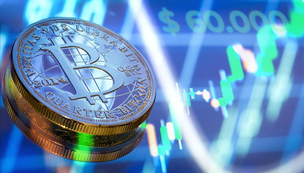Precio de bitcoin se recupera y vuelve a apuntar hacia los 60.000 dólares
