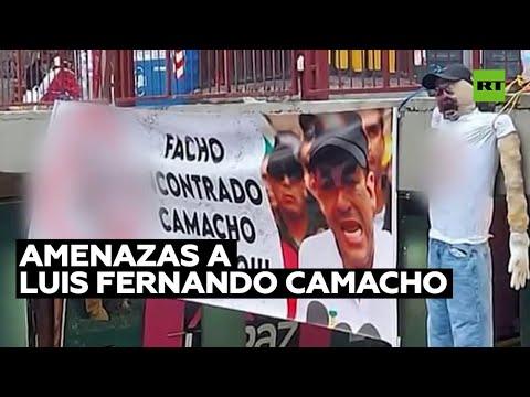 El gobernador del departamento boliviano de Santa Cruz es amenazado con pancartas y muñecos