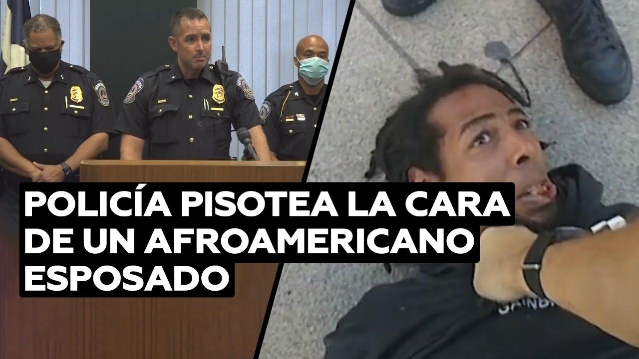 Un policía de EE.UU. patea en la cara a un afroamericano esposado @RT Play en Español