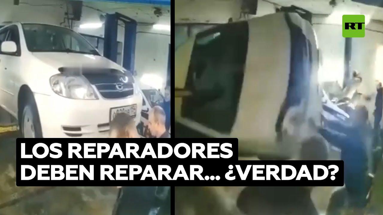 Mecánicos vuelcan el coche de un cliente por error @RT Play en Español
